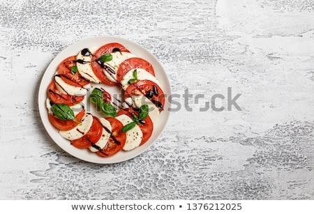 Finom olasz caprese saláta érett paradicsomok friss Stock fotó © karandaev