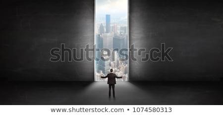 Człowiek patrząc naprzód górę wieżowiec biznesmen Zdjęcia stock © ra2studio