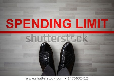 Businessman's Foot Near The Spending Limit Red Line Stock photo © AndreyPopov