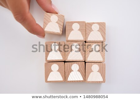 Businessperson's Hand Holding Cubic Block Stock photo © AndreyPopov