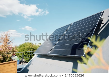 Large solar panels on rooftop of modern comfortable house or cottage Stock photo © pressmaster