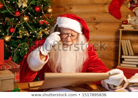 Mobile Santa with cellphone calling parents before Christmas Stock photo © pressmaster