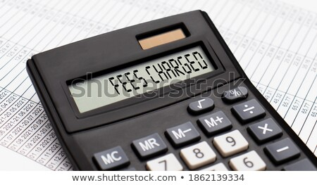 A calculator with the word Charges on the display Stock photo © Zerbor