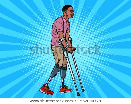 Africaine vétéran prothèse béquilles handicapées homme Photo stock © studiostoks
