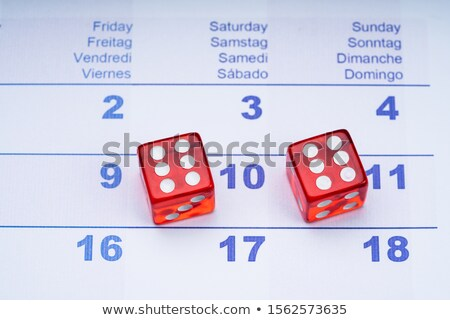 Two Transparent Red Dice On Calendar Stock photo © AndreyPopov