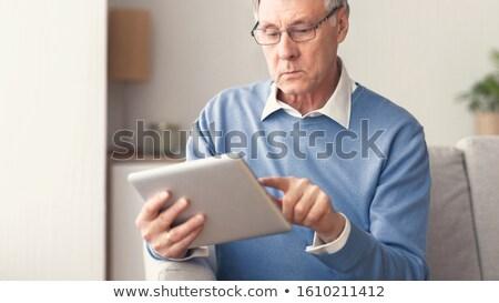 Senior uomo digitale tablet home felice Foto d'archivio © HighwayStarz