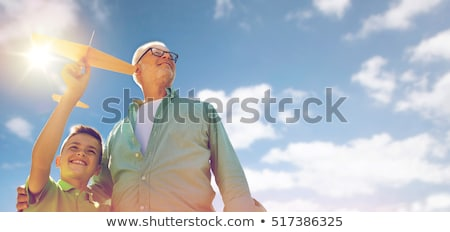young man over blue sky and clouds background Stock photo © dolgachov