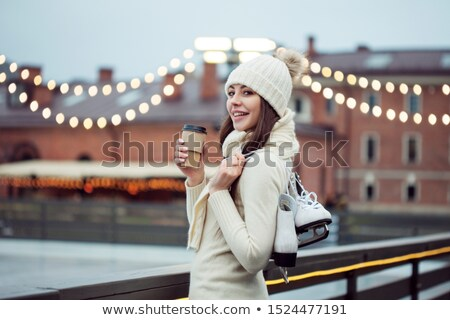 Girls Skating on Rink in Park, Winter Holidays Stock photo © robuart