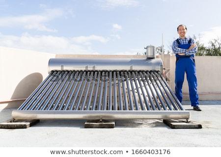 Werknemer permanente zonne-energie trots elektrische huis Stockfoto © AndreyPopov