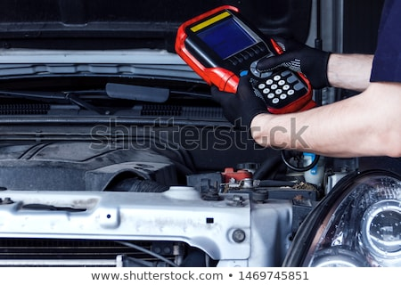 mechanic man with diagnostic scanner at car shop Stock photo © dolgachov