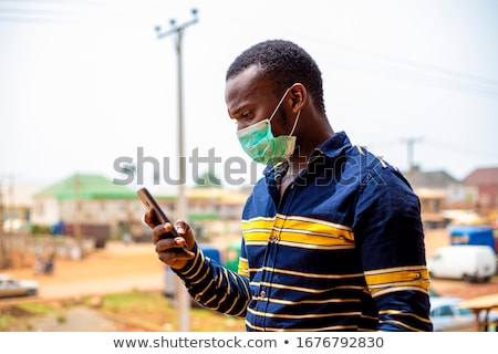 Coughing African Man Sick With Covid-19 Stock photo © AndreyPopov