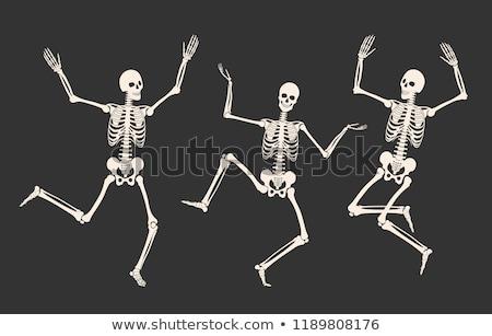 Esqueleto saltando ativo em torno de mão morto Foto stock © Harveysart