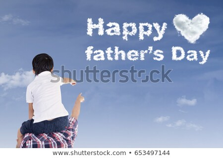 child sits at father on shoulders with lifted hands outdoors Stock photo © Paha_L