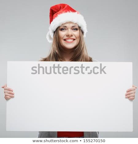 santa women holding a blank board Stock photo © feedough