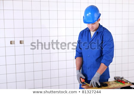 electrician is measuring copper wire length on a workbench Stock photo © photography33