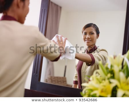 Stok fotoğraf: Asian Maid Working In Hotel Room And Smiling
