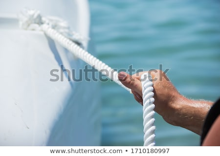 Stock photo: Hands of man tied up with rope