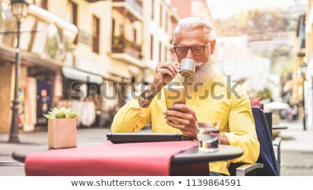 senior man using his laptop in a cafe stock photo © photography33