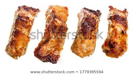 Barbecued pork ribs on white plate Stock photo © zhekos