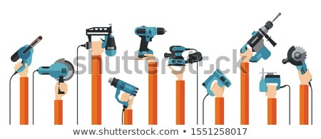 craftsman holding an electric saw stock photo © photography33