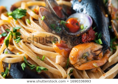 Pasta on clams mix on dish Stock photo © vetdoctor