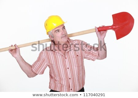 elderly labourer holding a spade stock photo © photography33