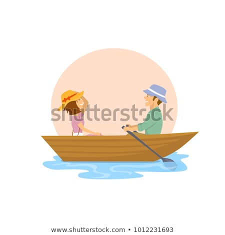 Stock photo: Couple in row boat fishing