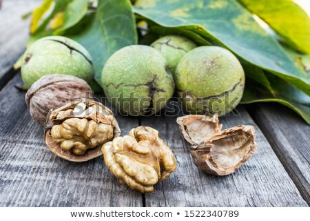 Walnuts and walnut kernels leaf next to it. Stock photo © justinb