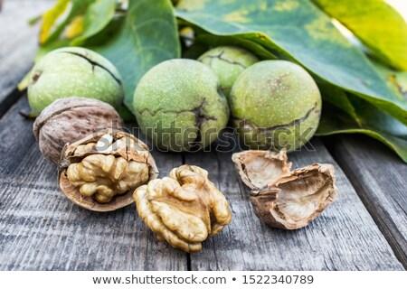 Walnuts and walnut kernels leaf next to it. stock photo © justinb