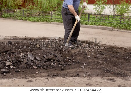 Worker digging with a shovel Stock photo © photography33
