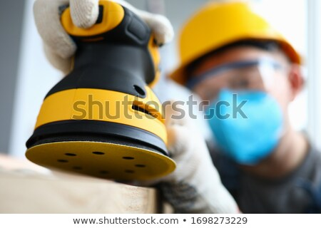 Construction worker holding up a sander Stock photo © photography33