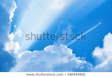 traces of planes and clouds in the sky stock photo © deyangeorgiev
