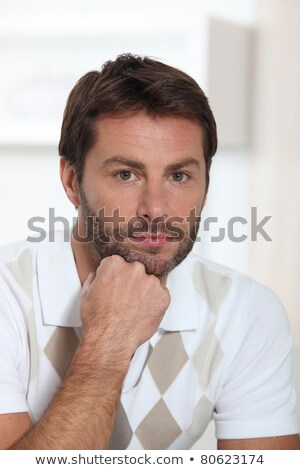 Portrait of a man with beard and mustache leaning his chin on his hand Stock photo © photography33