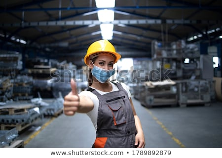 Construction worker showing thumbs up Stock photo © elenaphoto