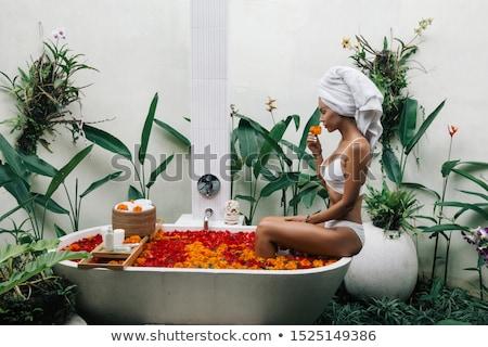 female take shower outdoors stock photo © anna_om