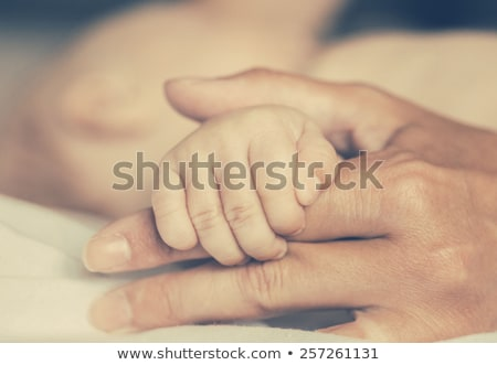 mother and son daughter holding feet stock photo © lunamarina