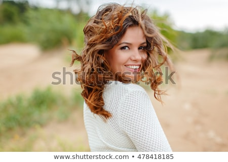 outdoors woman portrait with flying hair stock photo © chesterf