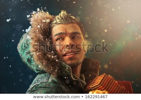 Brillante Foto hombre guapo Navidad regalos Foto stock © HASLOO