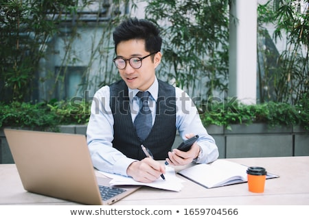 businessman writing stock photo © stevanovicigor