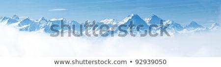 White Snow Peaks In Clouds Stok fotoğraf © vichie81