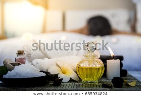 Vrouw spa massage bloemen cosmetica voorgrond Stockfoto © HASLOO