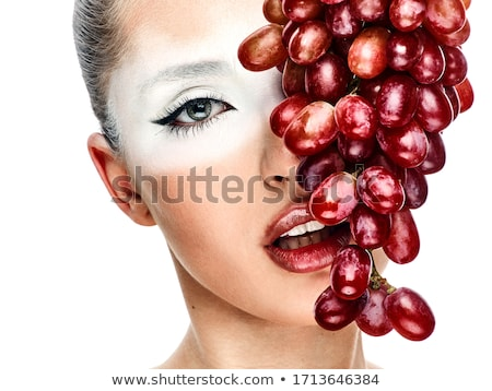 The girl with grapes stock photo © nizhava1956