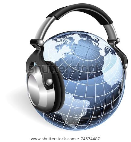 Monde terre monde écouter de la musique casque radio Photo stock © designers