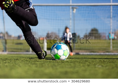 Kids soccer penalty kick Stock photo © bigandt