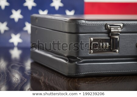 Leather Briefcase Resting on Table with American Flag Behind Stock photo © feverpitch