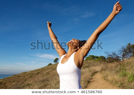 Beautiful woman with her arms wide open Stock photo © stockyimages
