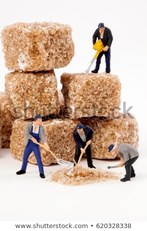 Miniature worker working on a sugar cube Stock photo © michaklootwijk