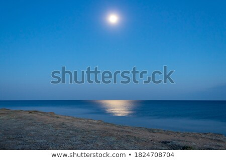 Moonlight over illuminated cliffs Stock photo © olandsfokus