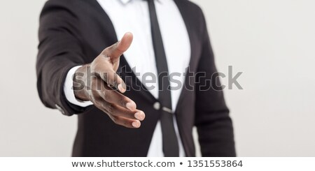 african businessman giving a hand isolated on white background focus on hand stock photo © deandrobot