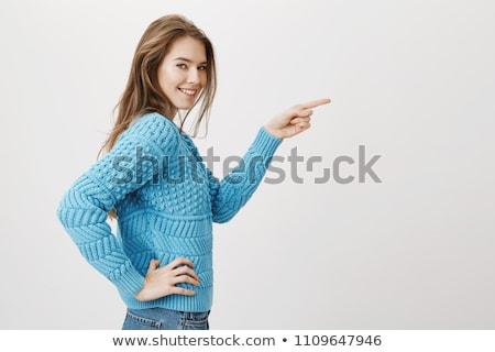 Flirtare donna guardando fotocamera Foto d'archivio © dash